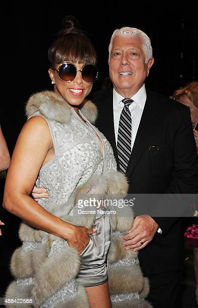 Marjorie Harvey and designer Dennis Basso attend Dennis Basso Front Row Backstage Spring 2016 New York Fashion Week The Shows at The Arc Skylight at...