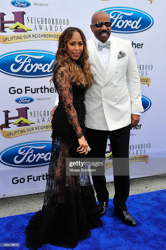 Marjorie Harvey (L) and Steve Harvey attend the 2014 Ford Neighborhood Awards Hosted By Steve Harvey at the Phillips Arena on August 9, 2014 in Atlanta, Georgia.