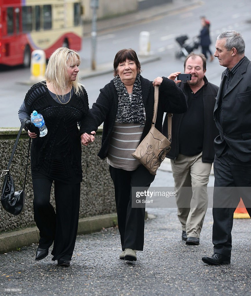 Marjorie Kidd (C), the mother of former stuntman Eddie Kidd, arrives at Brighton Magistrates Court to attend the trail of Samantha Kidd, the estranged wife of Eddie Kidd, who is charged with assaulting him on January 9, 2013 in Brighton, England. Samantha Kidd is accused of assaulting Mr Kidd, who is paralysed and brain-damaged after a stunt went wrong in August 1996, six times over a period of four months from July to October 2012.