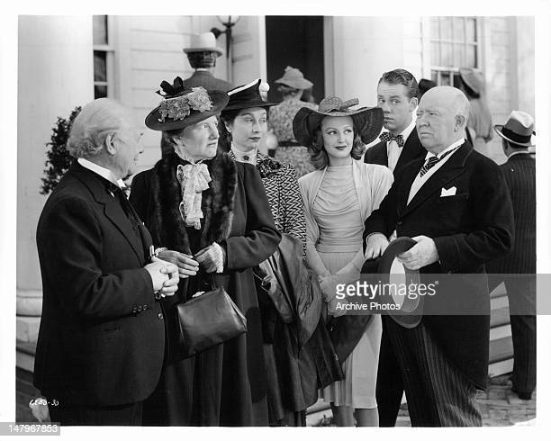 Marjorie Main and Guy Kibbee have an argument in front of the church as their amused friends watch in a scene from the film 'Tish' 1942