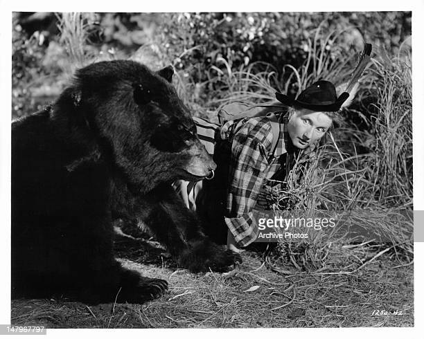 Marjorie Main is alarmed by an organgrinder's bear in a scene from the film 'Tish' 1942