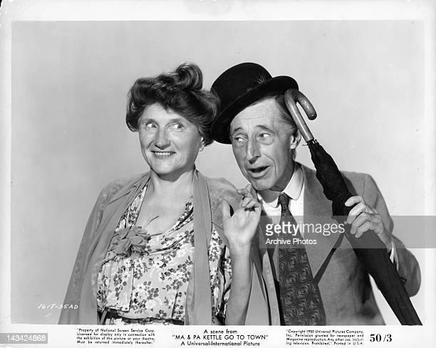 Marjorie Main pointing at umbrella carrying Percy Kilbride in a scene from the film 'Ma and Pa Kettle Go To Town' 1950