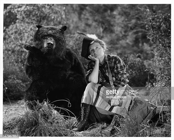 Marjorie Main relaxing with bear in a scene from the film 'Tish' 1942