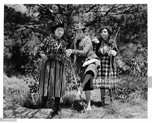 Marjorie Main Zasu Pitts and Aline MacMahon are about to start their hunting trip in a scene from the film 'Tish' 1942