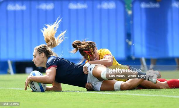 Marjorie Mayans of France dives over for a try during the Women's Rugby Sevens placing match between Spain and France on day 3 of the Rio 2016...