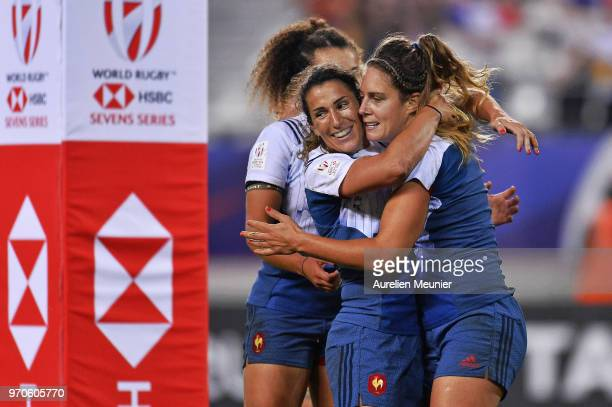 Marjorie Mayans of France is congratulated by teammate Shannon Izar after she scored a try during the Rugby Sevens match between Australia and France...