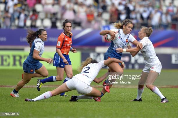 Marjorie Mayans of France is tackled by Abby Brown of England during match between England and France at the HSBC Paris Sevens stage of the Rugby...