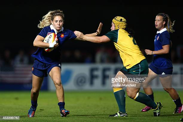 Marjorie Mayans of France is tackled by Louise Burrows of Australia during the IRB Women's Rugby World Cup Pool C match between Australia and France...