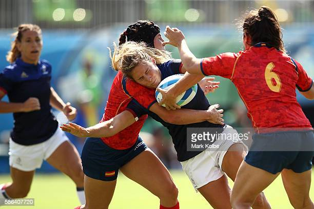 Marjorie Mayans of France is tackled by Marina Bravo and Elisabet Martinez of Spain during a Women's Pool B rugby match between France and Spain on...