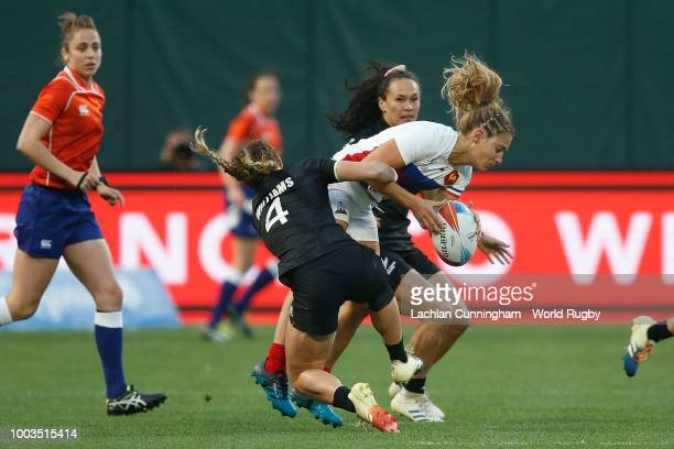 Marjorie Mayans of France is tackled by Niall Williams of New Zealand during the Championship match on day two of the Rugby World Cup Sevens at ATT...