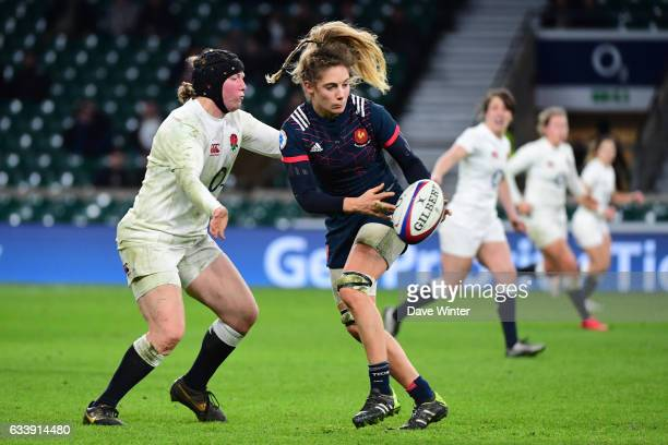 Marjorie Mayans of France is tackled by Rochelle Clark of England during the Women's RBS Six Nations match between England and France at Twickenham...