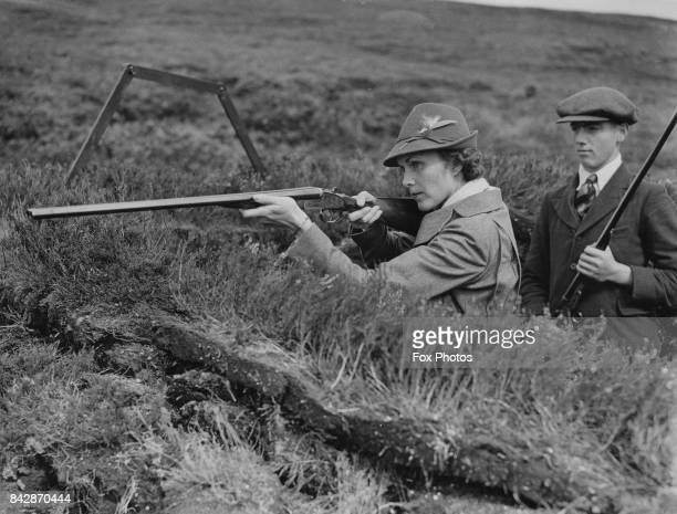 Marjorie Merriweather Post the former wife of Edward Francis Hutton goes grouse shooting on Fetteresso Moor in Kincardineshire Scotland as the guest...