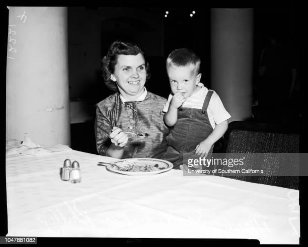 Marjorie Saint, 7 October 1957. Marjorie Saint;Phillip Saint -- 2 years .;Caption slip reads: 'Assignment: Saint. 29-30-39-40: Marjorie Saint, and...