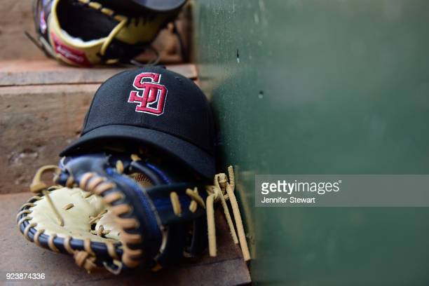 Marjory Stoneman Douglas High School hat is seen on top of a glove in the dugout during the game between the Los Angeles Dodgers and Kansas City...