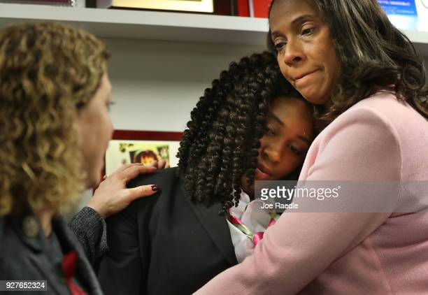 Marjory Stoneman Douglas High School mass shooting survivor MeiLing HoShing is comforted by Rosalind Osgood a Broward County School Board member and...