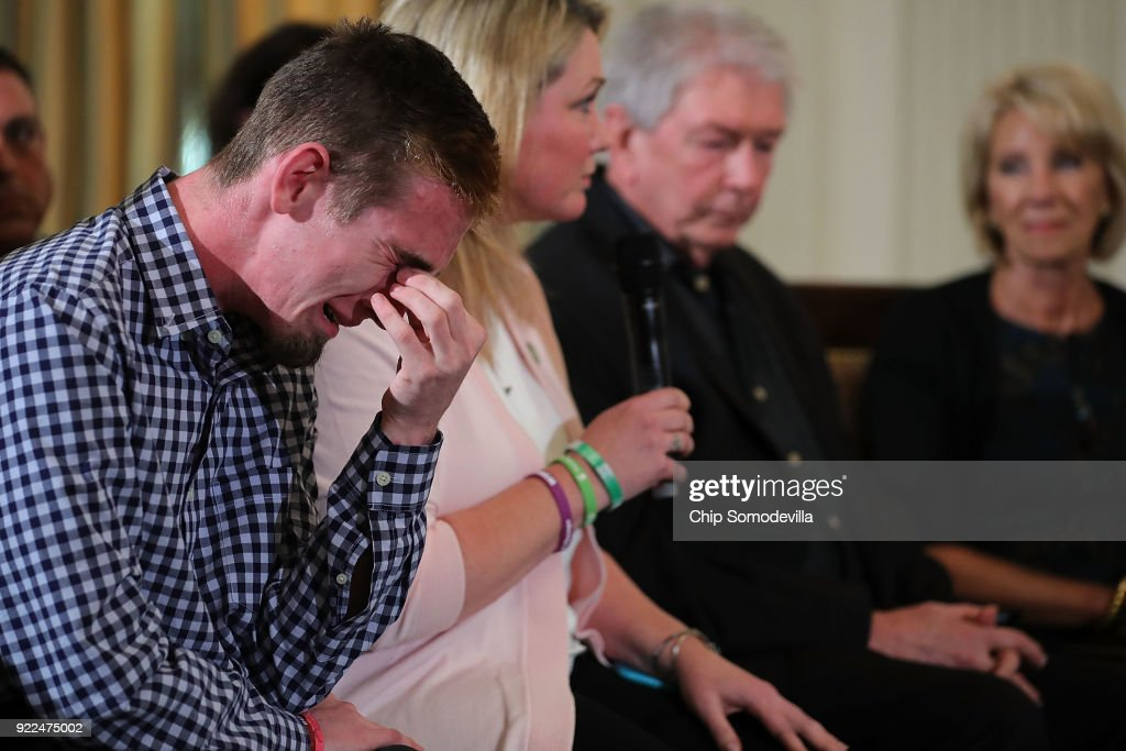 Marjory Stoneman Douglas High School senior Samuel Zeif weeps after talking about how his best friend was killed during last week's mass shooting while he participates in a listening session hosted by U.S. President Donald Trump in the State Dining Room at the White House February 21, 2018 in Washington, DC. Trump is hosting the session in the wake of last week's mass shooting at Douglas High School in Parkland, Florida, that left 17 students and teachers dead.