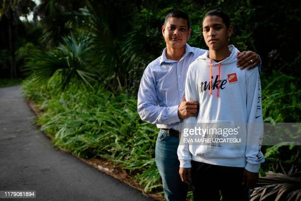 Marjory Stoneman Douglas High School shooting survivor Anthony Borges and his father Royer Borges pose for a photo during an interview with AFP in...