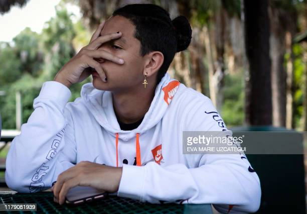 Marjory Stoneman Douglas High School shooting survivor Anthony Borges speaks during an interview with AFP in Coral Springs, Florida, on August 9,...