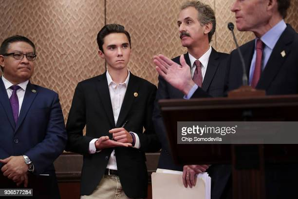 Marjory Stoneman Douglas High School shooting survivor David Hogg jots notes on his hand as he joins a news conference with Rep Salud Carbajal Los...