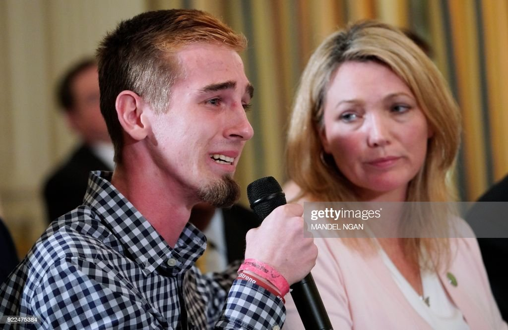 Marjory Stoneman Douglas High School shooting survivor Samuel Zeif (L) speaks during a listening session on gun violence with US President Donald Trump, teachers and students in the State Dining Room of the White House on February 21, 2018. At right is Nicole Hockley, parent of a Sandy Hook shooting victim. /