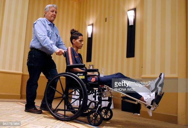 Marjory Stoneman Douglas High School shooting victim Anthony Borges is wheeled out of a press conference by his grandfather Alfredo Borges in...