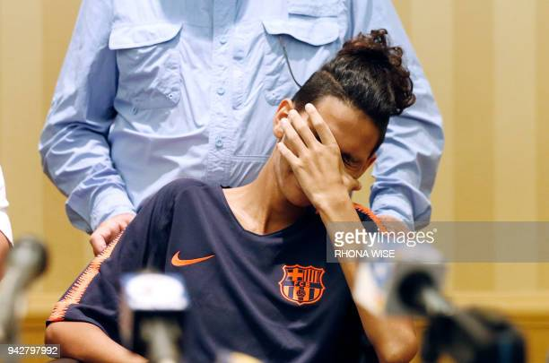 Marjory Stoneman Douglas High School shooting victim Anthony Borges reacts as he listens to a press conference in Plantation Florida on April 6 2018...