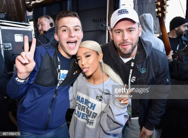 Marjory Stoneman Douglas High School student Cameron Kasky Ariana Grande and Scooter Braun attend March For Our Lives on March 24 2018 in Washington...