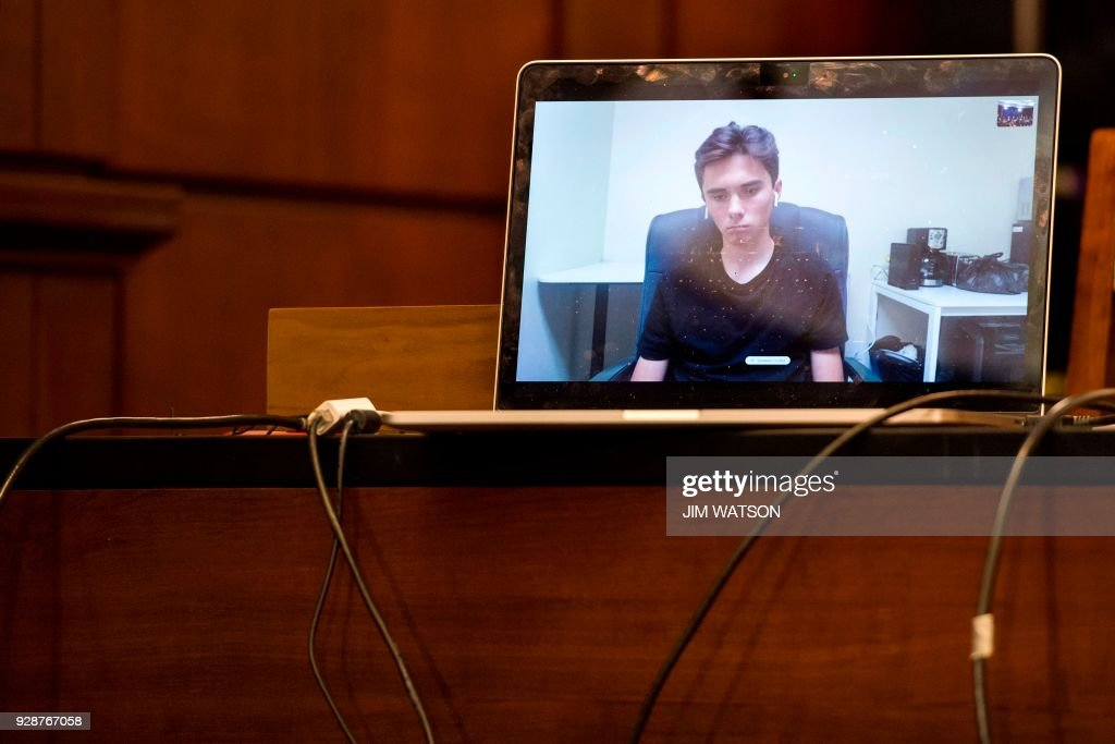 TOPSHOT - Marjory Stoneman Douglas High School student David Hogg speaks via Skype during a Democrat meeting to hear testimony from survivors of gun violence and family members who want Congress to take swift action to strengthen US gun laws, on Capitol Hill in Washington, DC, on March 7, 2018. /