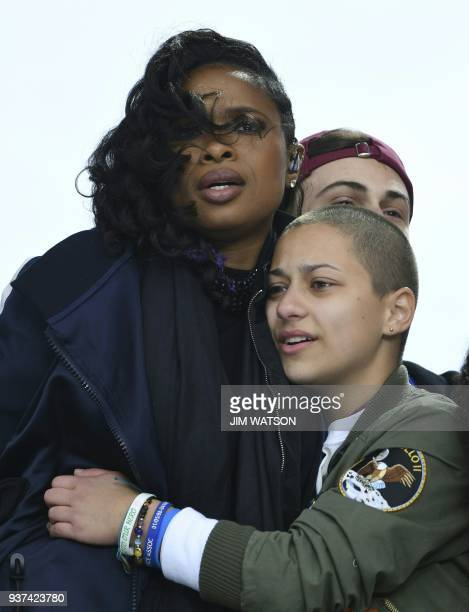 Marjory Stoneman Douglas High School student Emma Gonzalez and singer/actress Jennifer Hudson embrace during the March for Our Lives Rally in...