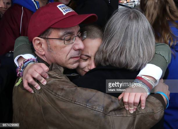 Marjory Stoneman Douglas High School student Emma Gonzalez hugs her parents backstage after speaking at the March for Our Lives rally on March 24...