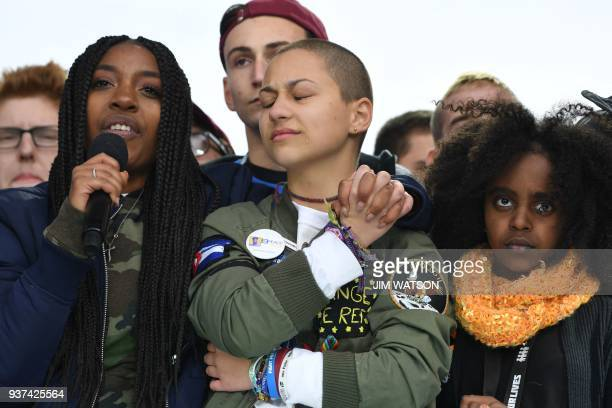 TOPSHOT Marjory Stoneman Douglas High School student Emma Gonzalez listens with other students during the March for Our Lives Rally in Washington DC...