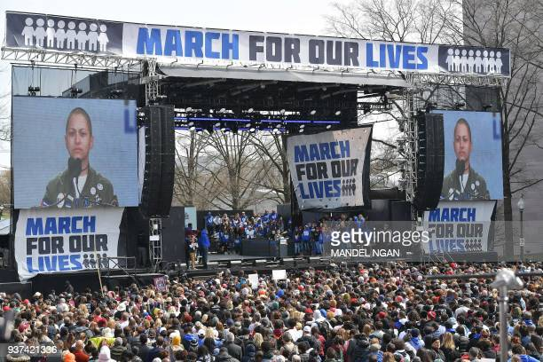 Marjory Stoneman Douglas High School student Emma Gonzalez pauses as she speaks during the March for Our Lives Rally in Washington DC on March 24...