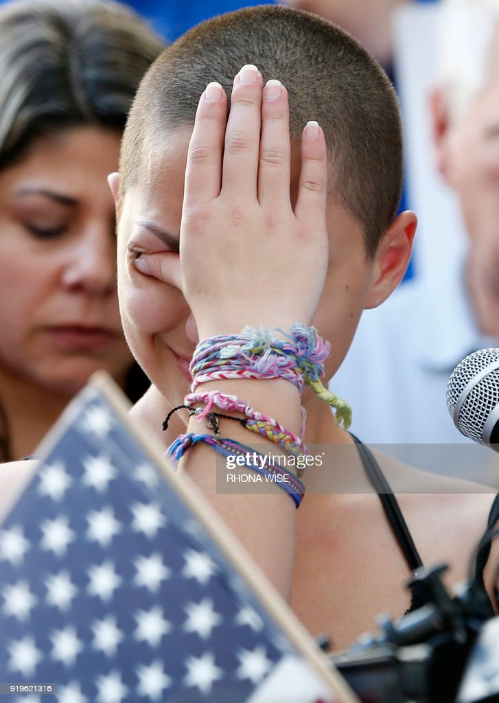 Marjory Stoneman Douglas High School student Emma Gonzalez reacts during her speech at a rally for gun control at the Broward County Federal Courthouse in Fort Lauderdale, Florida on February 17, 2018. A student survivor of the Parkland school shooting called out US President Donald Trump on Saturday over his ties to the powerful National Rifle Association, in a poignant address to an anti-gun rally in Florida. 'To every politician taking donations from the NRA, shame on you!' said Emma Gonzalez, assailing Trump over the multi-million-dollar support his campaign received from the gun lobby -- and prompting the crowd to chant in turn: 'Shame on you!' WISE