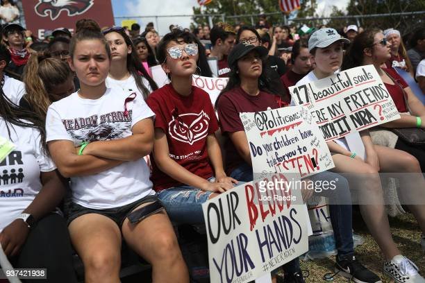 Marjory Stoneman Douglas High School students participate in the March For Our Lives event at Pine Trails Park before walking to the high school on...