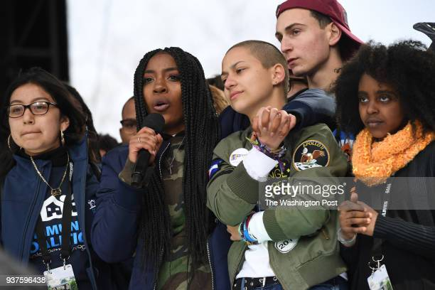 Marjory Stoneman Douglas High School students Tyra Hemans center embraces fellow student Emma Gonzalez near the conclusion of March for Our Lives on...