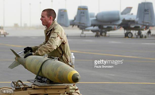 Mark 82500 lbs bombs are loaded onto a trailer as ordinance gets shifted to another aircraft on the flight line at an air base March 26 2003 in...