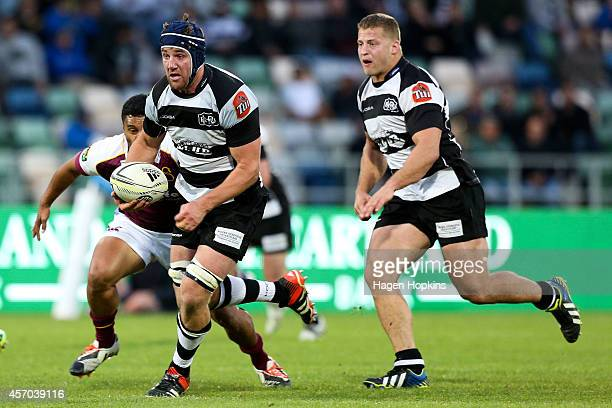 Mark Abbott of Hawke's Bay makes a break during the round nine ITM Cup match between Hawke's Bay and Southland at McLean Park on October 11 2014 in...