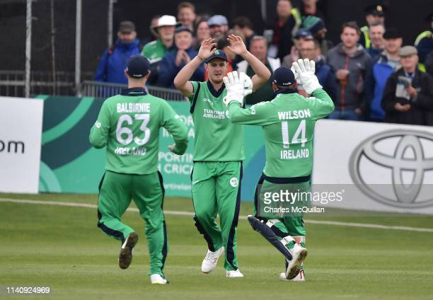 Mark Adair of Ireland catches to take the wicket of David Willey during the ODI cricket match between Ireland and England at Malahide Cricket Club on...