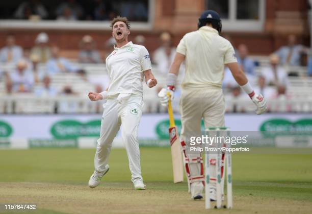 Mark Adair of Ireland celebrates after dismissing Joe Root of England during the second day of the Specsavers Test Match between England and Ireland...