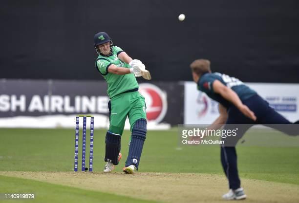 Mark Adair of Ireland hits a six during the ODI cricket match between Ireland and England at Malahide Cricket Club on May 3 2019 in Dublin Ireland