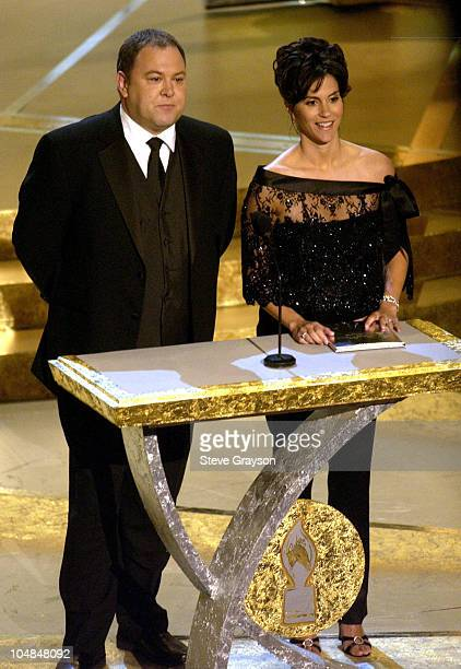 """Mark Addy and Jami Gertz present the award for Favorite Reality-Based Show to """"Survivor: Thailand"""" at the 29th Annual People's Choice Awards."""