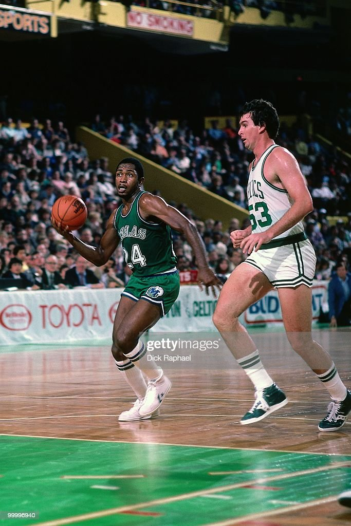 Mark Aguirre #24 of the Dallas Mavericks drives to the basket against Rick Robey #53 of the Boston Celtics during a game played in 1983 at the Boston Garden in Boston, Massachusetts.