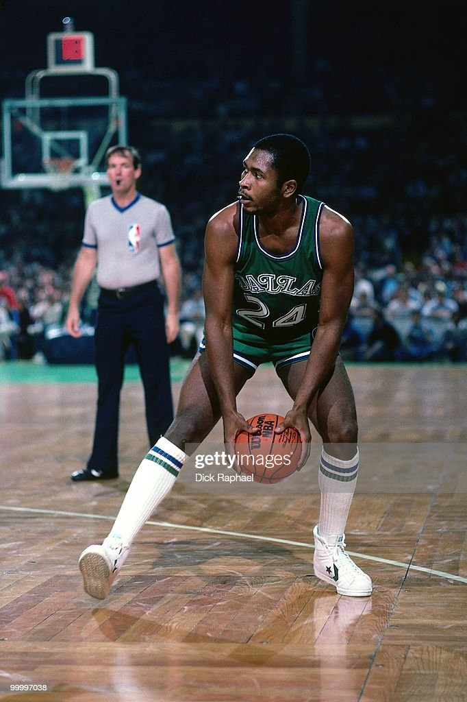 Mark Aguirre #24 of the Dallas Mavericks looks to make a move against the Boston Celtics during a game played in 1983 at the Boston Garden in Boston, Massachusetts.