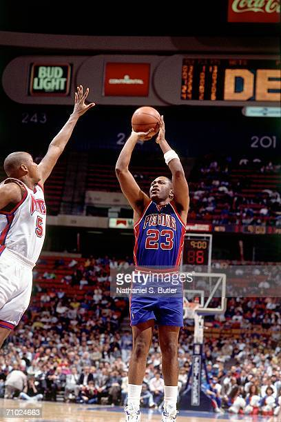 Mark Aguirre of the Detroit Pistons shoots a jump shot against Terry Mills of the New Jersey Nets during a game circa 1992 at the Brendan Byrne Arena...