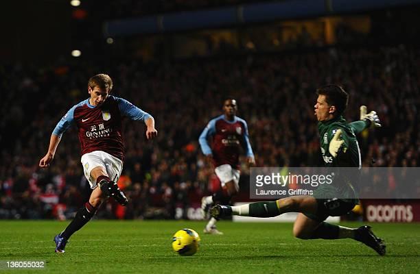 Mark Albrighton of Aston Villa scores the equaliser past Wojciech Szczesny of Arsenal during the Barclays Premier League match between Aston Villa...