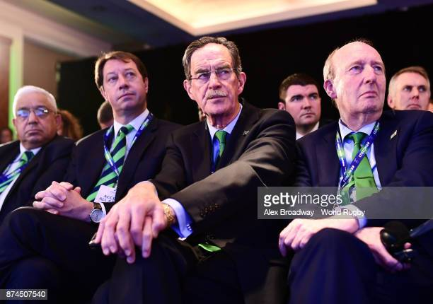 Mark Alexander President of SA Rugby Jurie Roux CEO of SA Rugby Dick Spring and Shane Ross Minister for Transport Tourism and Sport react during the...