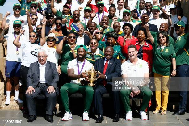 Mark Alexander, the President of the South African Rugby Union and Rassie Erasmus , head coach of South Africa, pose for a photograph while South...