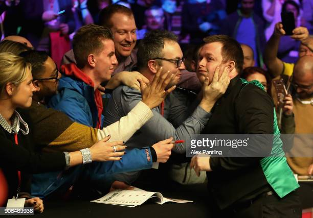 Mark Allen celebrates victory with supporters following The Dafabet Master Final between Kyren Wilson and Mark Allen at Alexandra Palace on January...