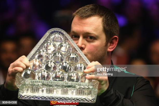 Mark Allen kisses the trophy as he celebrates victory following The Dafabet Master Final between Kyren Wilson and Mark Allen at Alexandra Palace on...