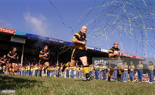 Mark Allen leads the Wellington Hurricanes onto the pitch at Athletic Park for the Super 12 clash v the Queensland Reds